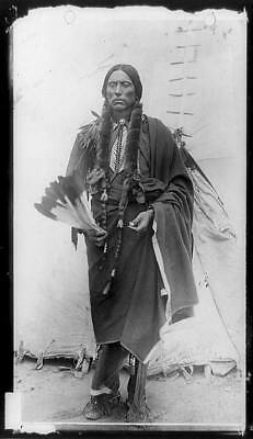 Quanah Parker,Comanche Indian Chief,holding feathers,tepee,Native American,c1920