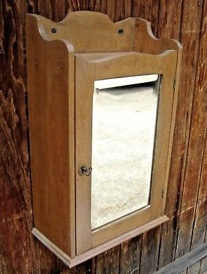 Antique Chestnut Medicine Cabinet With Beveled Mirror Door Has A Lock 478