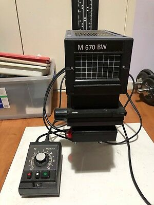 Durst M670 BW photo enlarger and accessories for darkroom.