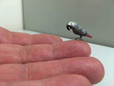 A beautiful handcrafted 1/12th African grey parrot