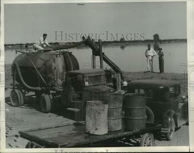1934 Press Photo  Jack Sterrett on truck pumping water which distribute to ranch