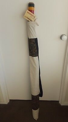 Hand-crafted didjeridoo with certificate of authenticity and carry bag