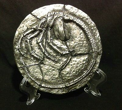 Fossilized Alien Facehugger metallic replica