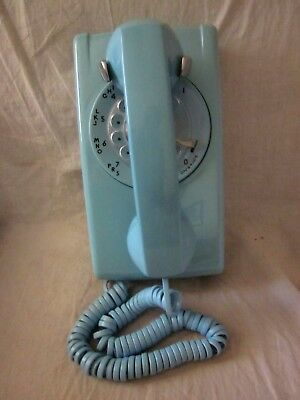 554 Rotary Dial Wall Telephone in Aqua Blue Color.