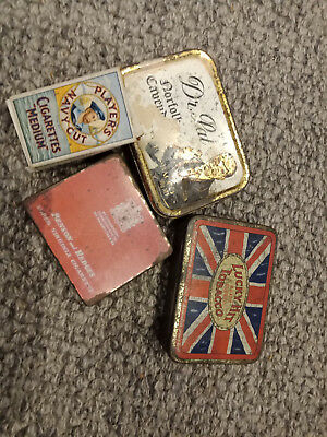 Old cigarette tins and a  players packet