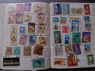Stamp album lot of 213 rare stamps!! Some scarce dead contry stamps cool