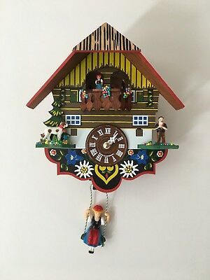 Cuckoo Clock - with lady on a swing and four moving people