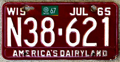 1965 White on Burgundy Wisconsin License Plate with a 1967 Sticker