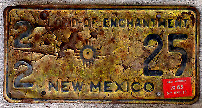 Black on Yellow New Mexico License Plate with a 1965 Sticker