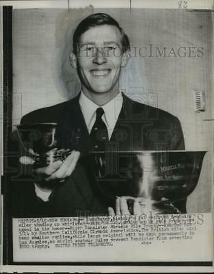 Press Photo Roger Bannister, World's Fist Four Minute Mile Runner with Trophy