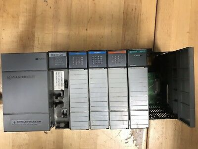 PRE OWNED 1746-P2 POWER SUPPLY AND 1746-A7 CHASSIS With Cards