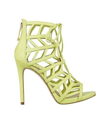 734c316086c4  110 Guess Women s Anasia Caged High Heels In Yellow Lace Up Size 7