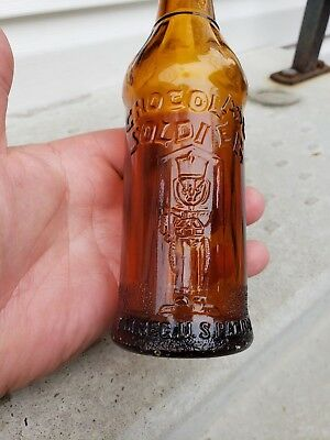 Rare Chocolate Soldier soda bottle, Hornell N.Y.  in a orange amber color