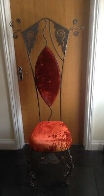 Handmade bespoke wrought iron chair with a crushed velvet seat pad.