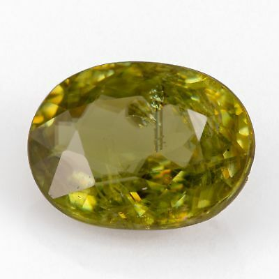 2.08ct Sphene (Titanite). An oval cut, yellowish green gem, with rainbow flash.
