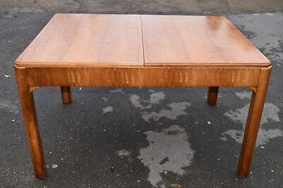 An Arts And Crafts Walnut Dining  Table