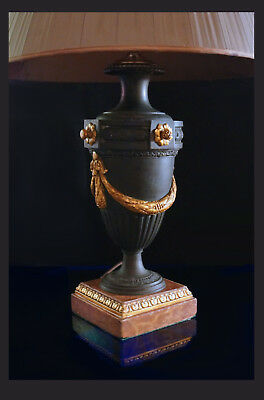 A Large Louis XVI Style Iron/Metal Urn On A Wooden Marbleized Base, 47,0 CM H.