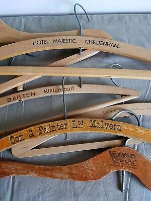 Six Vintage Wooden Advertising Coat Hangers