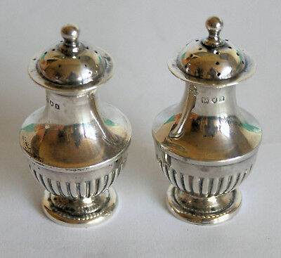 A pair of silver small pepperettes, Goldsmiths, London 1905/6