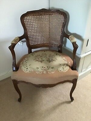 Antique tapestry and cane chair