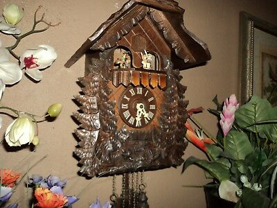 German Black Forest Carved Musical Cuckoo Clock With Spinning Hummel Figures