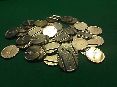 50. .....22mm X 2 mm BRASS TOKENS, 2 GROOVES, VENDING, GAMING, ECT