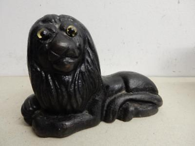 really OLD cast iron LION door stop glass eyes
