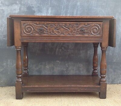 18th century style oak table with long heavily carved drawer & extension flaps