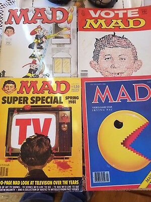 4 Mad Magazines.  Still in GREAT condition