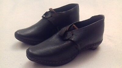 Victorian pair of child's handmade leather and wooden clogs with metal buckles