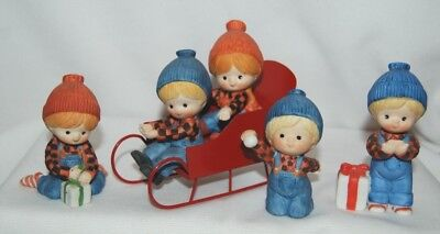 Enesco Country Cousins On Sled Girl With Gift, Boy With Gift, Boy With Snowball