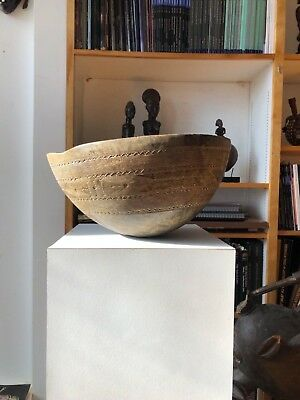 Antique wooden bowl from Africa with engraved pattern