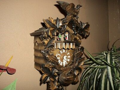 Beautiful German Black Forest Carved Musical Cuckoo Clock With Spinning Dancers