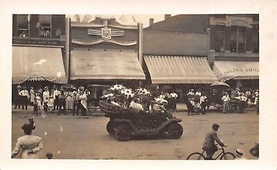 Atlantic IA Parade Float in Front of Nelson, Shrock & Grulke Clothing RPPC 1920s