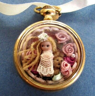 Miniature Antique Reproduction Bisque Porcelain Doll in Pocket Watch