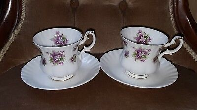 Two Royal Albert Sweet Violets cups and saucers.