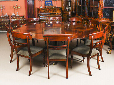 """Vintage 7ft 4"""" Diameter Flame  Mahogany Jupe Dining Table & 10 Chairs mid 20th C"""