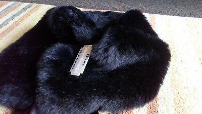Black soft and luxurious faux fur shrug new with tags. Never been worn.