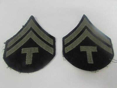 WWII US Army pair of T-CPL ranks sewn.