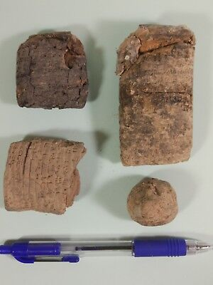 Four Clay Tablets with script.