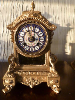 Old gilded & porcelain striking mantel clock