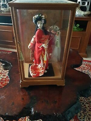 A Geisha Lady  In A Glass Dome.