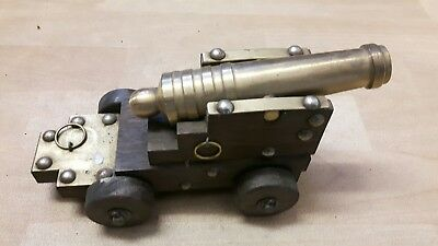 vintage Brass Cannon on a wooden base