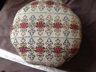 victorian footstool with upholstered top and ceramic feet