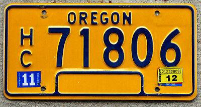 Classic Blue on Orange Oregon License Plate with a 2012 Sticker