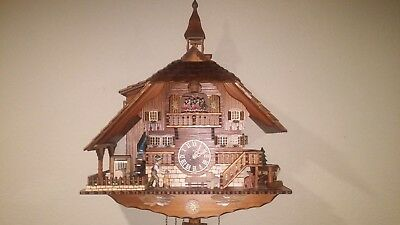 Large 8 Day Musical Bell Tower Wood Chopper Sawing Cuckoo Clock