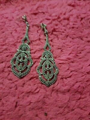 A  Pair Of  Masicite Earrings
