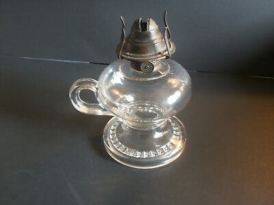 antique oil  footed fingerlamp