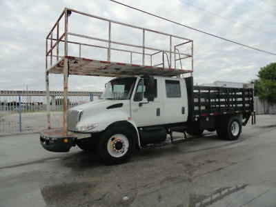 2005 International 4400 Crew Cab Flatbed With Steel Stake Racks Liftgate