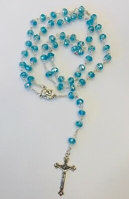 Rosary Of Light Blue Acrylic Beads With Crucifix In Silver